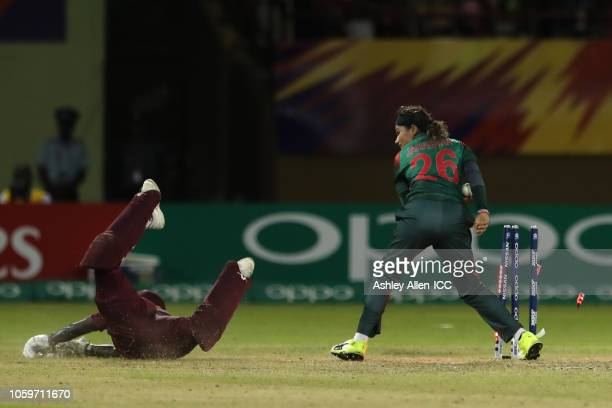 Kycia Knight of the Windies makes her ground as Jahanara Alam of Bangladesh attempts to run her out at Providence Stadium during match 3 Windies...