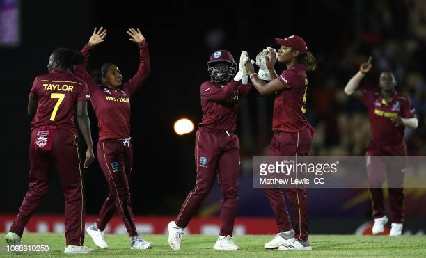 Kycia Knight of West Indies and Hayley Matthews of West Indies celebrate the wicket of Oshadi Ranasinghe of Sri Lanka during the ICC Women's World...