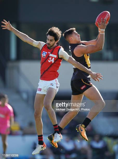 Kye Declase of Werribee marks the ball against Jake Long of Essendon during the round 13 VFL match between Werribee and Essendon at Avalon Airport...