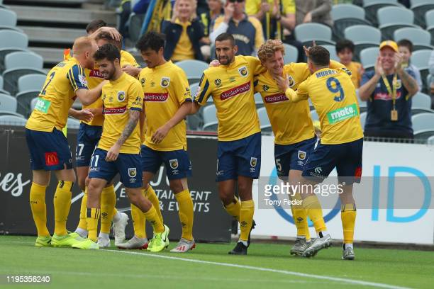 Kye Rowles of the Central Coast Mariners celebrates a goal with team mates during the round 11 ALeague match between the Central Coast Mariners and...