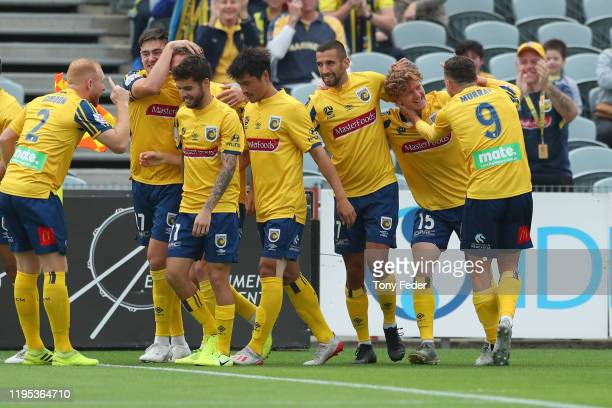 Kye Rowles of the Central Coast Mariners celebrates goal with team mates during the round 11 ALeague match between the Central Coast Mariners and...