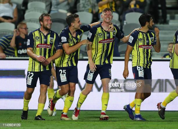 Kye Rowles of the Central Coast Mariners celebrates with team mates after scoring a goal during the round 26 A-League match between the Central Coast...