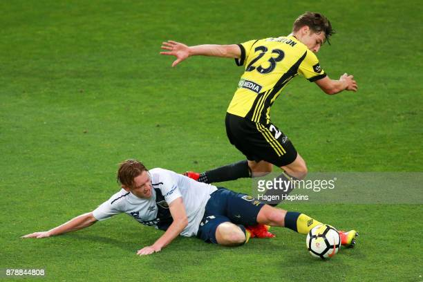 Kye Rowles of the Mariners tackles Matthew Ridenton of the Phoenix during the round eight ALeague match between the Wellington Phoenix and the...