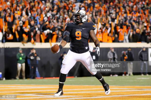 Kye Staley of the Oklahoma State Cowboys celebrates his first quarter touchdown against the Baylor Bears at Boone Pickens Stadium on November 23 2013...