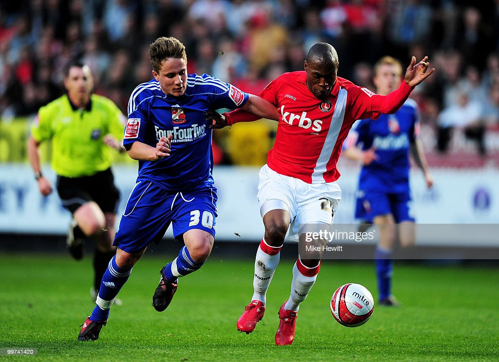 Kyel Reid of Charlton is challenged by Simon Ferry of Swindon during the Coca-Cola League One Playoff Semi Final 2nd Leg between Charlton Athletic and Swindon Town at The Valley on May 17, 2010 in London, England.