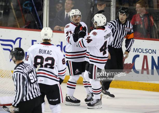 Kyen Sopa of the Niagara IceDogs celebrates a goal with Akil Thomas during the second period of an OHL game against the Barrie Colts at Meridian...