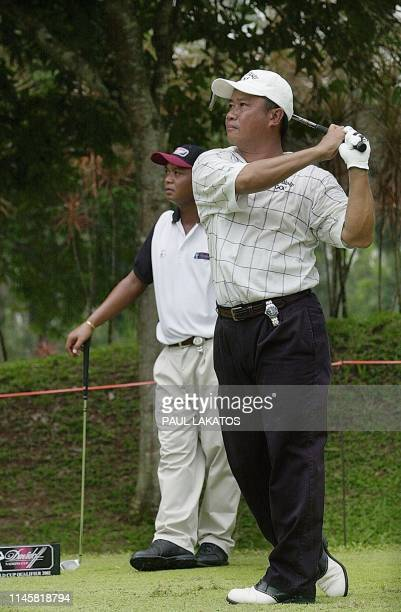 Kyi Hla Han of Myanmar watches his shot along with his compatriot Soe Kyaw Naing, on day one of the Davidoff Nations Cup World Cup Qualifier at the...
