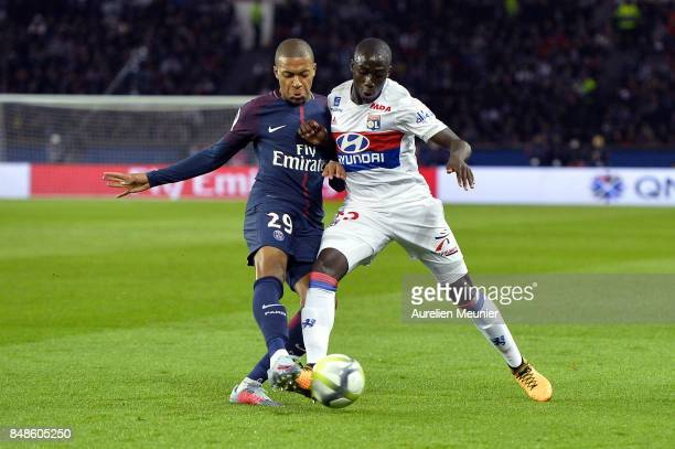 Kyian Mbappe of Paris SaintGermain and Tanguy Ndombele of Olympique Lyonnais fight for the ball during the Ligue 1 match between Paris Saint Germain...