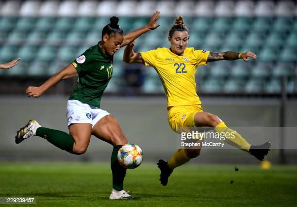 Kyiv , Ukraine - 23 October 2020; Rianna Jarrett of Republic of Ireland has a shot on goal despite the attention of Daria Kravets of Ukraine during...