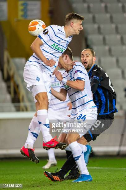 Kyiv's Tomasz Kedziora and Club's Bas Dost fight for the ball during a game between Belgian soccer team Club Brugge KV and Ukrainian FC Dynamo Kyiv,...