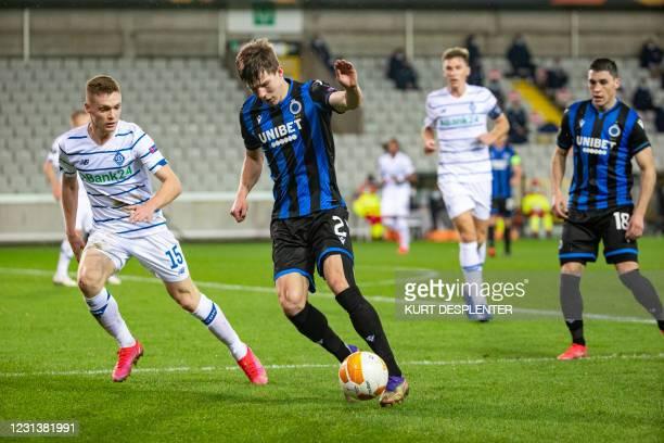 Kyiv's Viktor Tsyhankov and Club's Eduard Sobol fight for the ball during a game between Belgian soccer team Club Brugge KV and Ukrainian FC Dynamo...