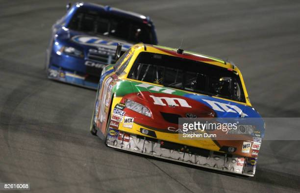 Kyke Busch drives the M&M's Toyota ahead of Kurt Busch in the Miller Lite Dodge during the NASCAR Sprint Cup Series Pepsi 500 at Auto Club Speedway...