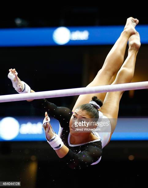 Kyla Ross competes on the uneven bars in the senior women finals during the 2014 PG Gymnastics Championships at Consol Energy Center on August 23...