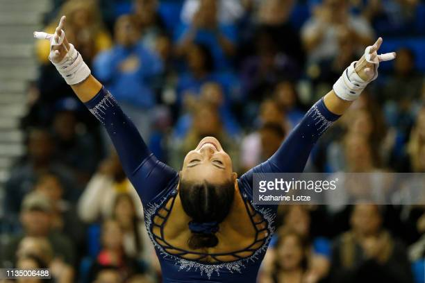 Kyla Ross dismounts from her uneven parallel bars routine during a meet against Stanford at Pauley Pavilion on March 10 2019 in Los Angeles California