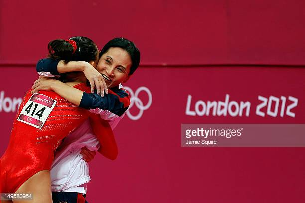 Kyla Ross of the United States of America and coach Jenny Zhang hug during the Artistic Gymnastics Women's Team final on Day 4 of the London 2012...