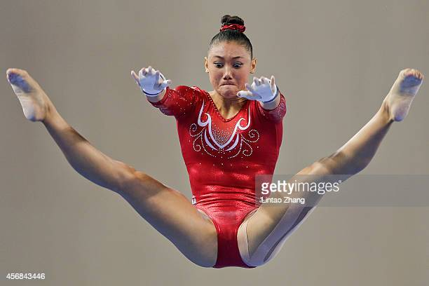 Kyla Ross of the United States performs on the uneven bars during the Women's Team Final on day two of the 45th Artistic Gymnastics World...