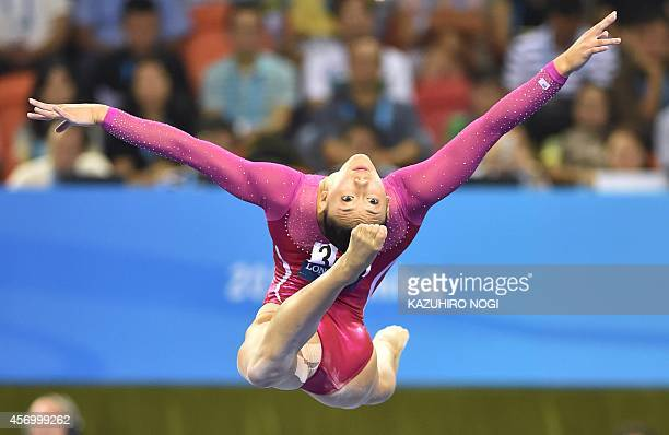 Kyla Ross of the US performs on the balance beam during the women's allaround final at the Gymnastics World Championships in Nanning on October 10...