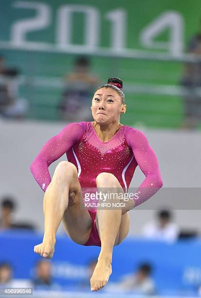 Kyla Ross of the US performs on the floor during the women's allaround final at the gymnastics world championships in Nanning on October 10 2014 AFP...