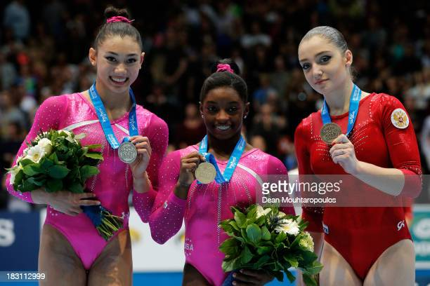 Kyla Ross of USA Simone Biles of USA and Aliya Mustafina of Russia pose after the Womens AllRound Final on Day Five of the Artistic Gymnastics World...