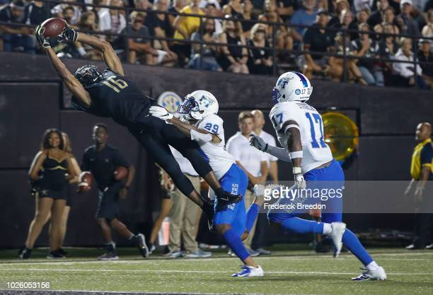 Kylan Stribling and Darryl Randolph of the Middle Tennessee Blue Raiders watch as Kalija Lipscomb of the Vanderbilt Commodores makes a diving...