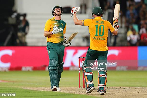 Kyle Abbott and David Miller celebrate during the 1st KFC T20 International match between South Africa and Australia at Sahara Stadium Kingsmead on...