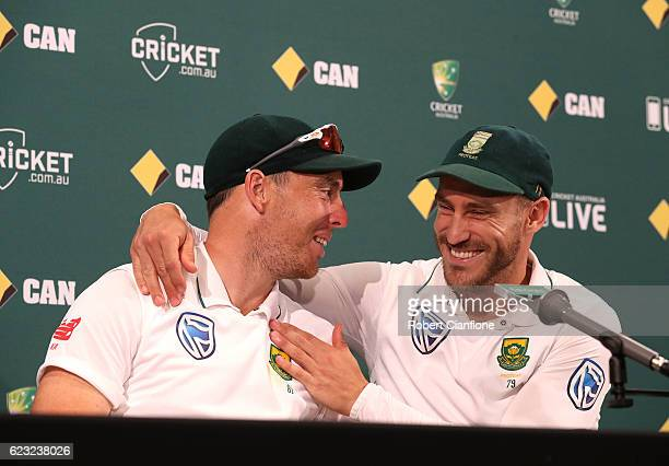 Kyle Abbott and Faf du Plessis of South Africa laugh during a press conference after day four of the Second Test match between Australia and South...