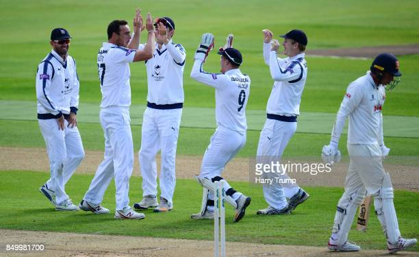 Kyle Abbott of Hampshire celebrates after dismissing Dan Lawrence of Essex during Day Two of the Specsavers County Championship Division One match...