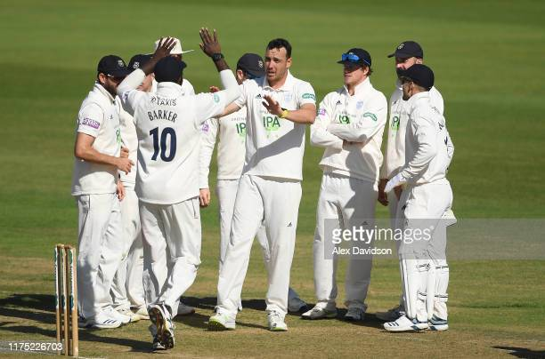 Kyle Abbott of Hampshire celebrates the wicket of Lewis Gregory of Somerset with his teammates during Day Two of The Specsavers Division One County...