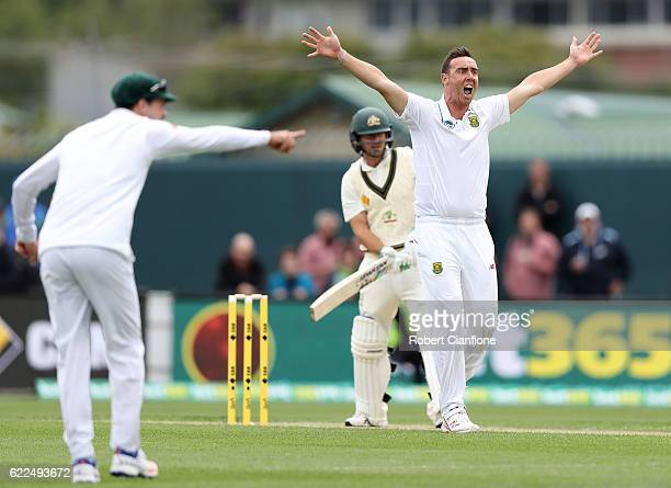 Kyle Abbott of South Africa appeals for the wicket of Joe Burns of Australia during day one of the Second Test match between Australia and South...