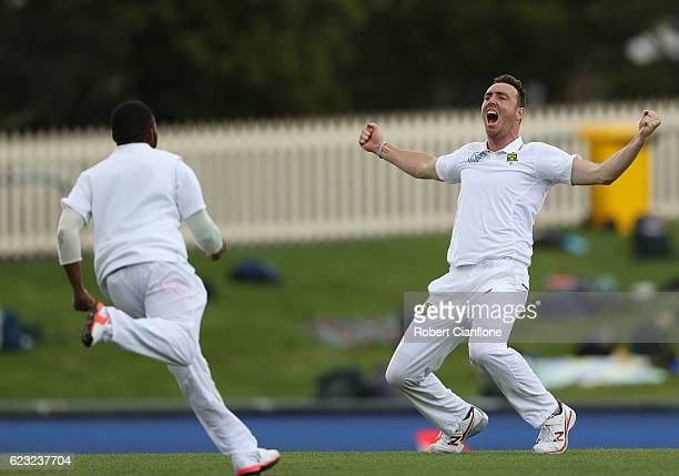 Kyle Abbott of South Africa celebrates after taking the final wicket to give South Africa victory over Australia during day four of the Second Test...