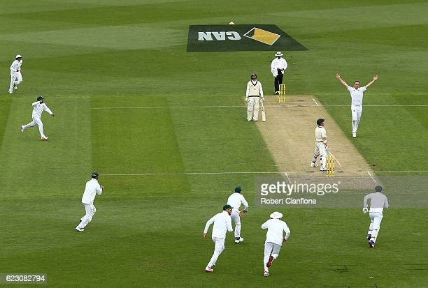 Kyle Abbott of South Africa celebrates after taking the wicket of David Warner of Australia during day three of the Second Test match between...
