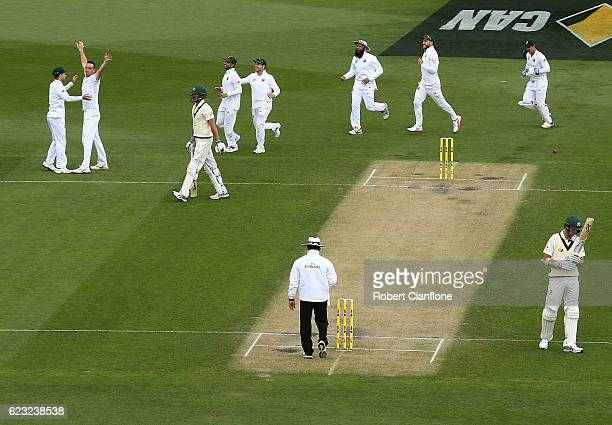 Kyle Abbott of South Africa celebrates after taking the wicket of Mitchell Starc of Australia during day four of the Second Test match between...