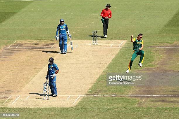 Kyle Abbott of South Africa celebrates dismissing Kusal Perera of Sri Lanka during the 2015 ICC Cricket World Cup match between South Africa and Sri...