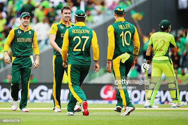 Kyle Abbott of South Africa celebrates with AB de Villiers Rilee Rossouw and David Miller of South Africa after claiming the wicket of Sohaib Maqsood...