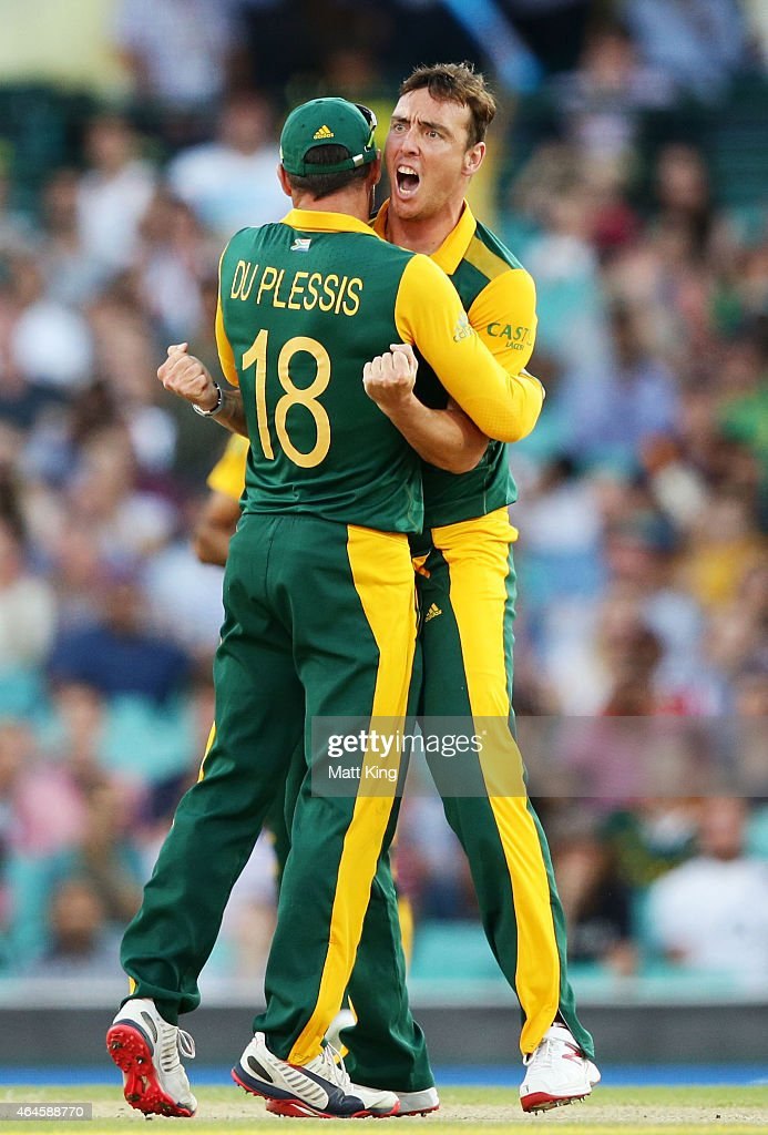 Kyle Abbott of South Africa (R) celebrates with Faf du Plessis (L) after taking the wicket of Chris Gayle of West Indies during the 2015 ICC Cricket World Cup match between South Africa and the West Indies at Sydney Cricket Ground on February 27, 2015 in Sydney, Australia.