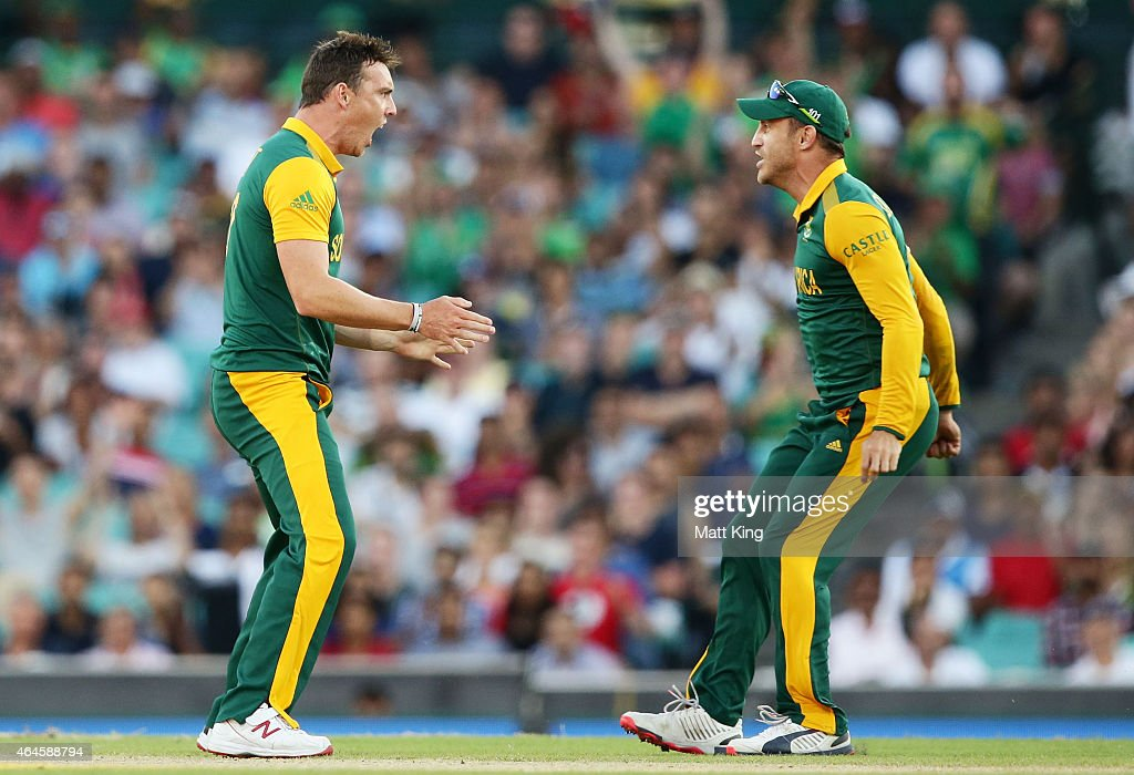 Kyle Abbott of South Africa (L) celebrates with Faf du Plessis (R) after taking the wicket of Chris Gayle of West Indies during the 2015 ICC Cricket World Cup match between South Africa and the West Indies at Sydney Cricket Ground on February 27, 2015 in Sydney, Australia.