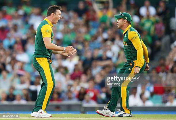Kyle Abbott of South Africa celebrates with Faf du Plessis after taking the wicket of Chris Gayle of West Indies during the 2015 ICC Cricket World...