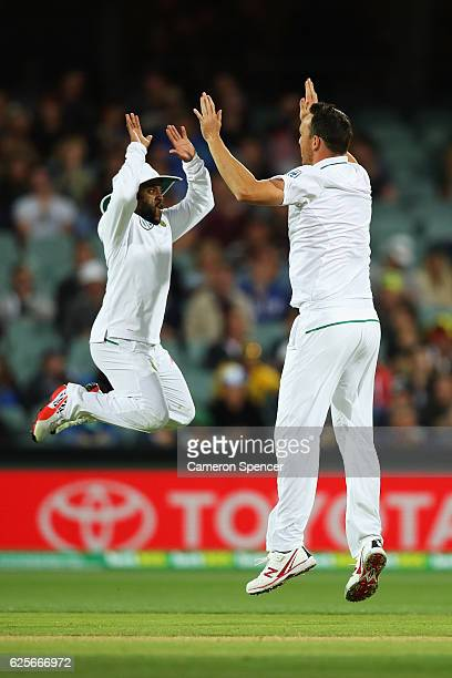 Kyle Abbott of South Africa celebrates with team mate Temba Bavuma after dismissing Peter Handscomb of Australia during day two of the Third Test...