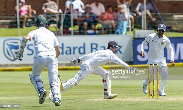 Kyle Abbott of South Africa is run out by Dinesh Chandimal of Sri Lanka during day 2 of the 1st Test match between South Africa and Sri Lanka at St...