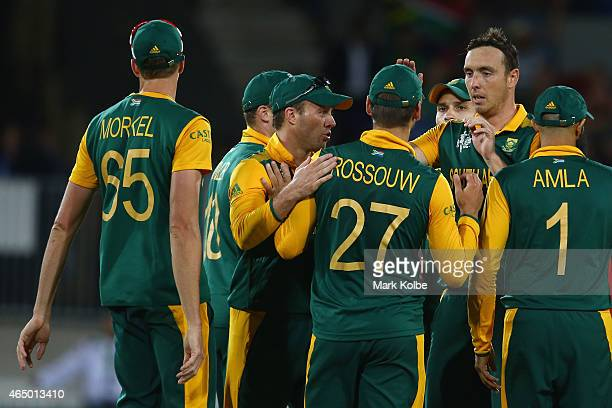Kyle Abbott ra celebrates with his team mates after taking the wicket of Kevin O'Brien of Ireland during the 2015 ICC Cricket World Cup match between...