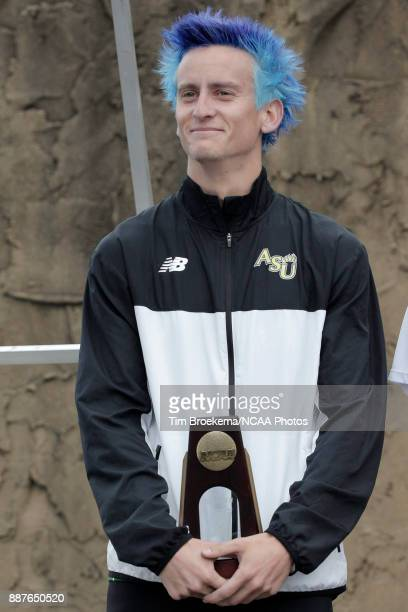 Kyle Adams of Adams State University is photographed with his third place trophy during the Division II Men's Cross Country Championship held at the...