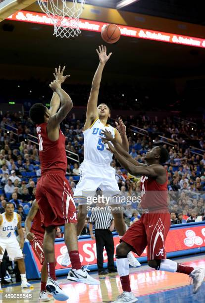 Kyle Adams of the UCLA Bruins shoots over Shannon Hale of the Alabama Crimson Tide at Pauley Pavilion on December 28, 2013 in Los Angeles, California.