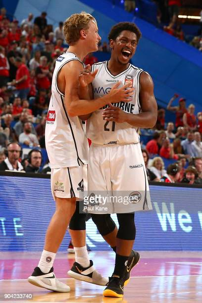 Kyle Adnam and Casper Ware of United celebrate winning the round 14 NBL match between the Perth Wildcats and Melbourne United at Perth Arena on...