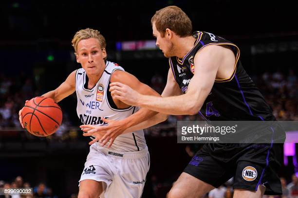 Kyle Adnam of Melbourne controls the ball during the round 12 NBL match between the Sydney Kings and Melbourne United at Qudos Bank Arena on December...