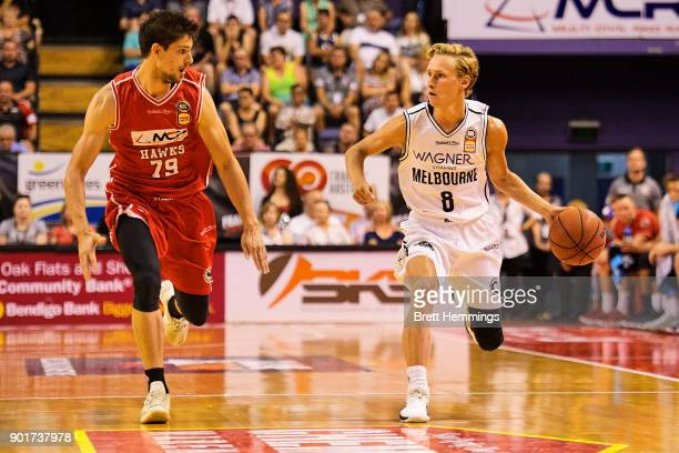 Kyle Adnam of Melbourne controls the ball during the round 13 NBL match between the Illawarra Hawks and Melbourne United at Wollongong Entertainment...