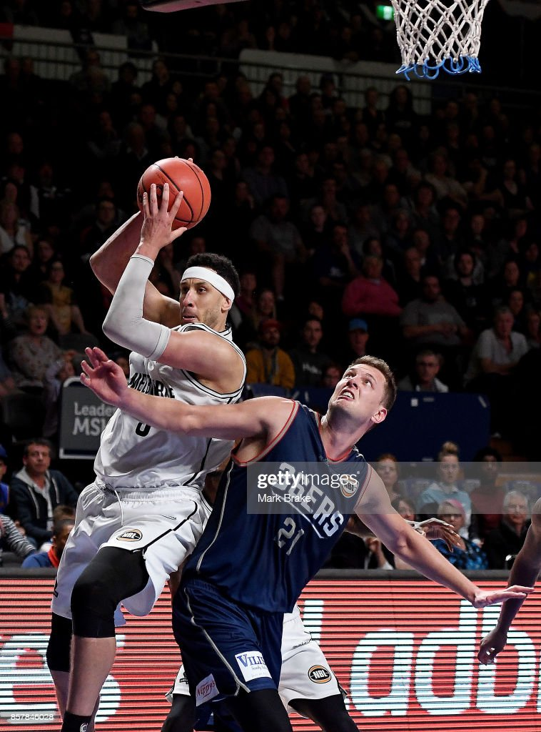 Kyle Adnam of Melbourne United and Daniel Johnson of the Adelaide 36ers during the round one NBL match between the Adelaide 36ers and Melbourne United at Titanium Security Arena on October 5, 2017 in Adelaide, Australia.
