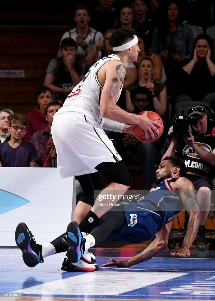 Kyle Adnam of Melbourne United knocks over Ramone Moore of the Adelaide 36ers for a charging foul during the round one NBL match between the Adelaide 36ers and Melbourne United at Titanium Security Arena on October 5, 2017 in Adelaide, Australia.