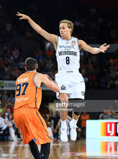Kyle Adnam of Melbourne United passes the ball during the round nine NBL match between the Cairns Taipans and Melbourne United at Cairns Convention...