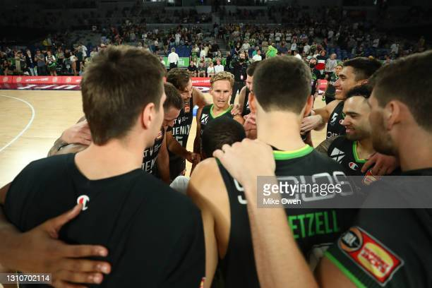 Kyle Adnam of the Phoenix celebrates with teammates after winning the round 12 NBL match between the South East Melbourne Phoenix and the New Zealand...