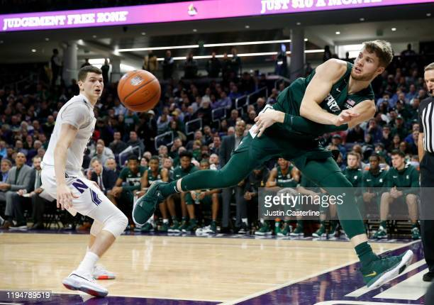 Kyle Ahrens of the Michigan State Spartans attempts to save the ball from going out of bounds in the game against the Northwestern Wildcats during...